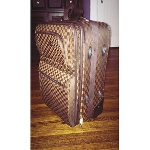Brown American Flyer suit case
